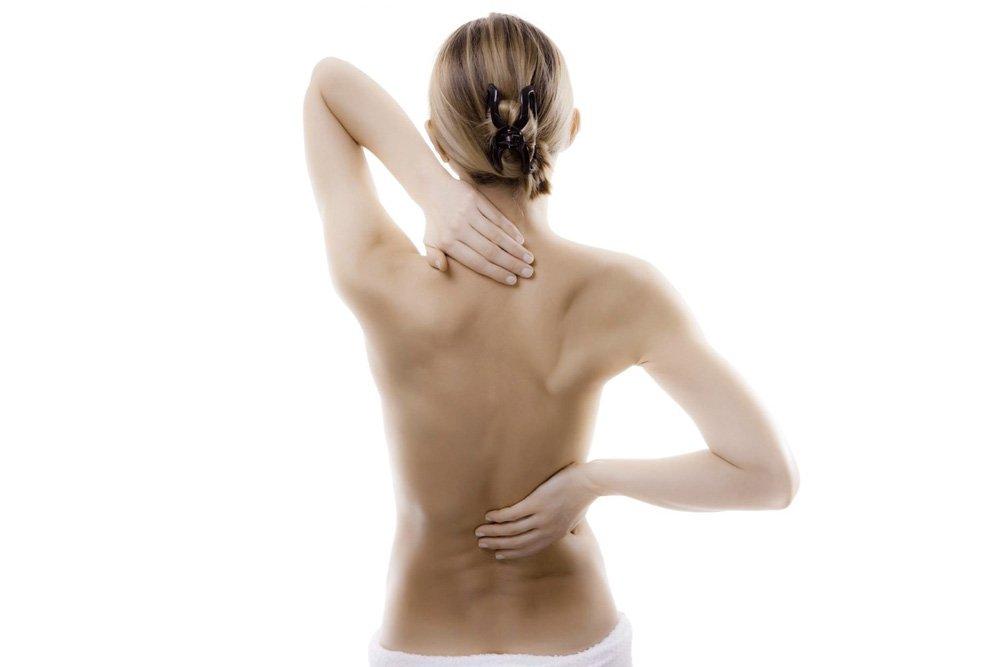 Боль в области спины и симптомы остеохондроза