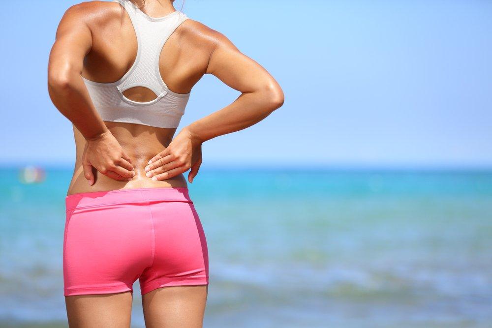 Почему возникают боли в спине
