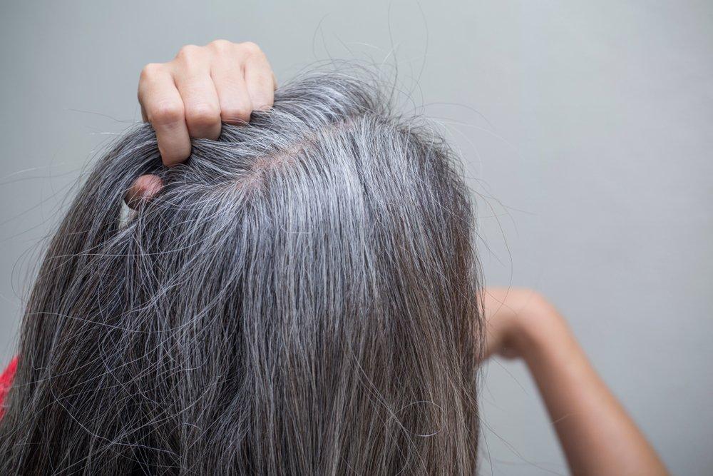 Почему седеют волосы: причины